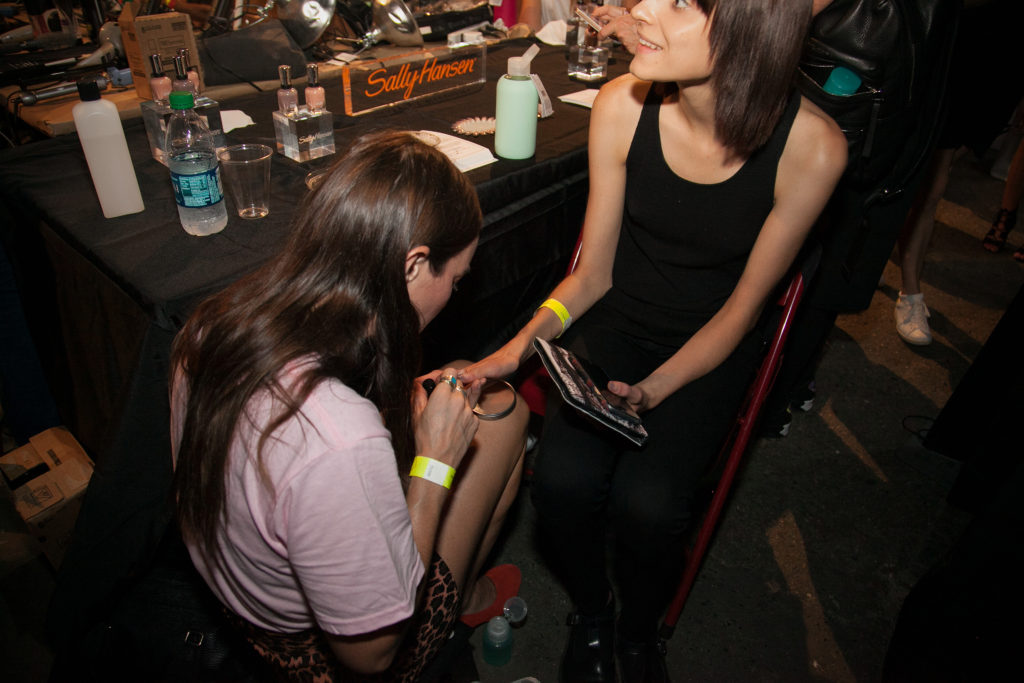Back stage at Monse Sally Hansen